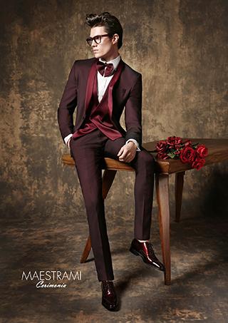 abito giuseppe rocchini nero con bottoni laterali e gilet rosso damascato